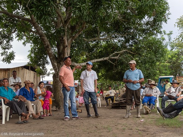 June 1, 2013. Global Ministries missionary Michael Joseph translates a call to action for our UCC delegation from a member of the community of El Guayabo; Pastor Salvador Alcantara of El Garzal looks on.