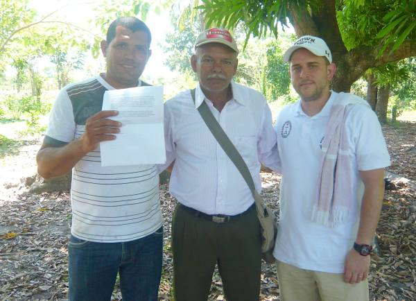 El Guayabo leaders Eric and Pastor Abel (of the El Guayabo Foursquare Church) with Global Ministries (Disciples of Christ and United Church of Christ) missionary Michael Joseph. Eric holds copies of the letters of support brought in by the delegation, some of which were written by members of the Connecticut Conference, United Church of Christ. [Photo courtesy of Michael Joseph]